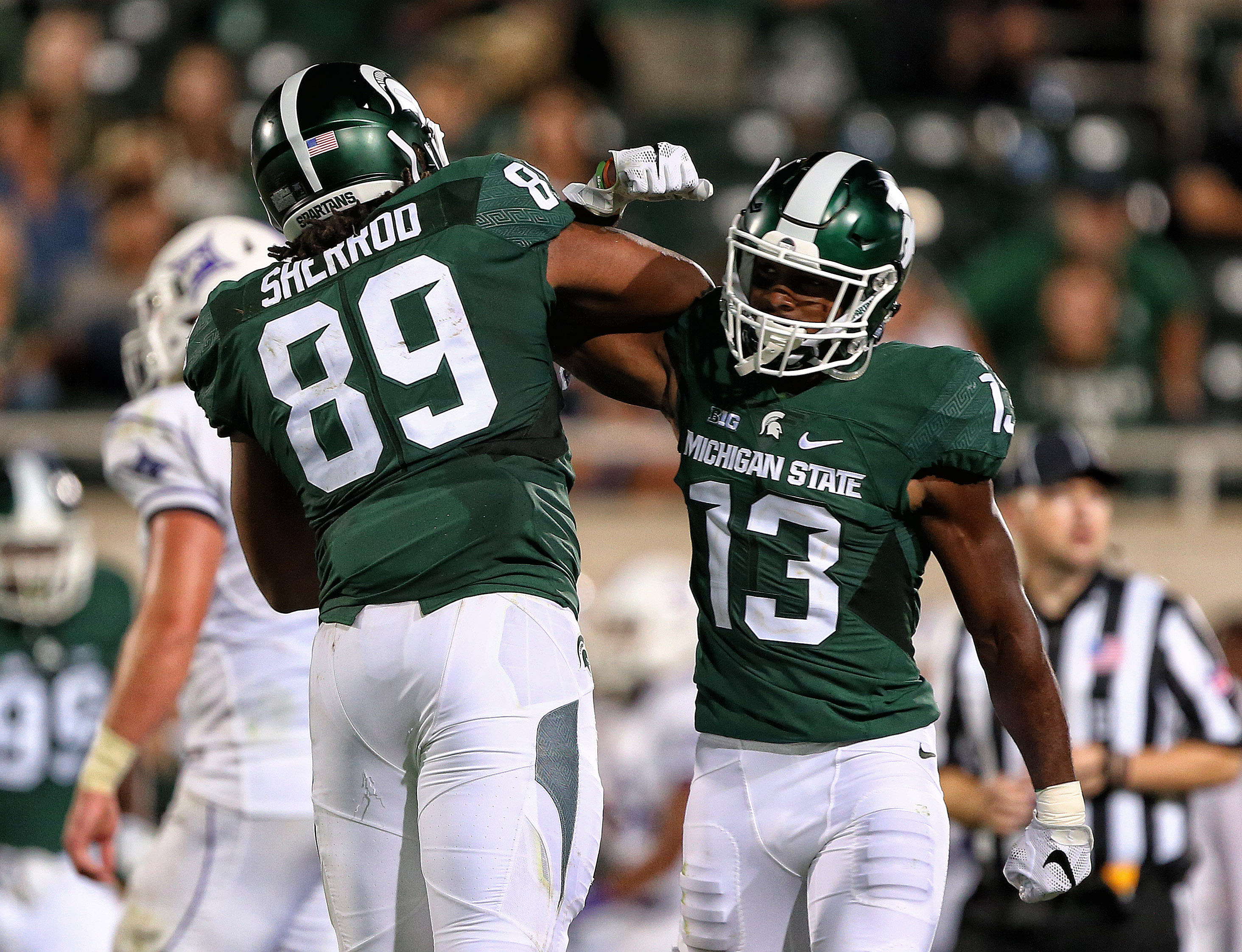 Sep 2, 2016; East Lansing, MI, USA; Michigan State Spartans defensive end Gabe Sherrod (89) celebrates with cornerback Vayante Copeland (13) after a defense stop during the second half against the Furman Paladins at Spartan Stadium. Mandatory Credit: Mike Carter-USA TODAY Sports