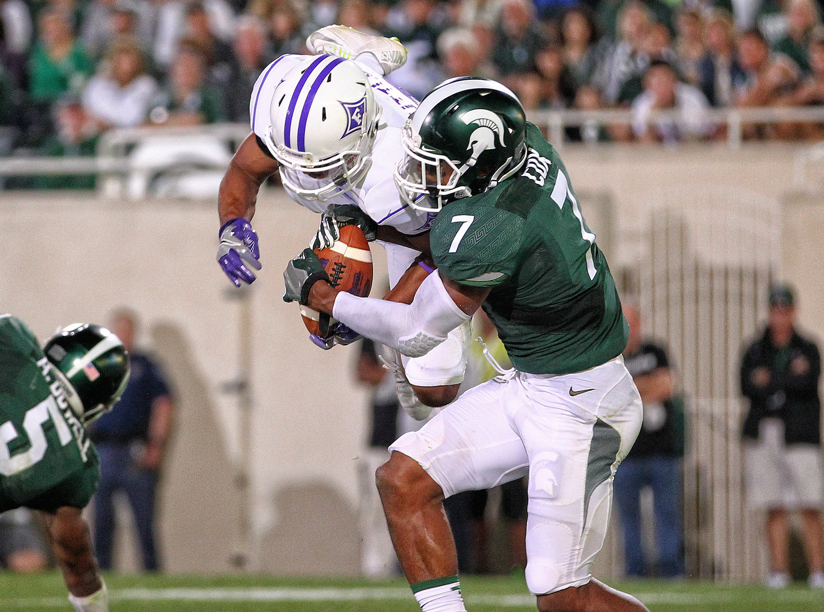 Sep 2, 2016; East Lansing, MI, USA; Michigan State Spartans defensive back Demetrious Cox (7) block a pass intended for Furman Paladins wide receiver Andrej Suttles (3) during the second half of a game at Spartan Stadium. Mandatory Credit: Mike Carter-USA TODAY Sports
