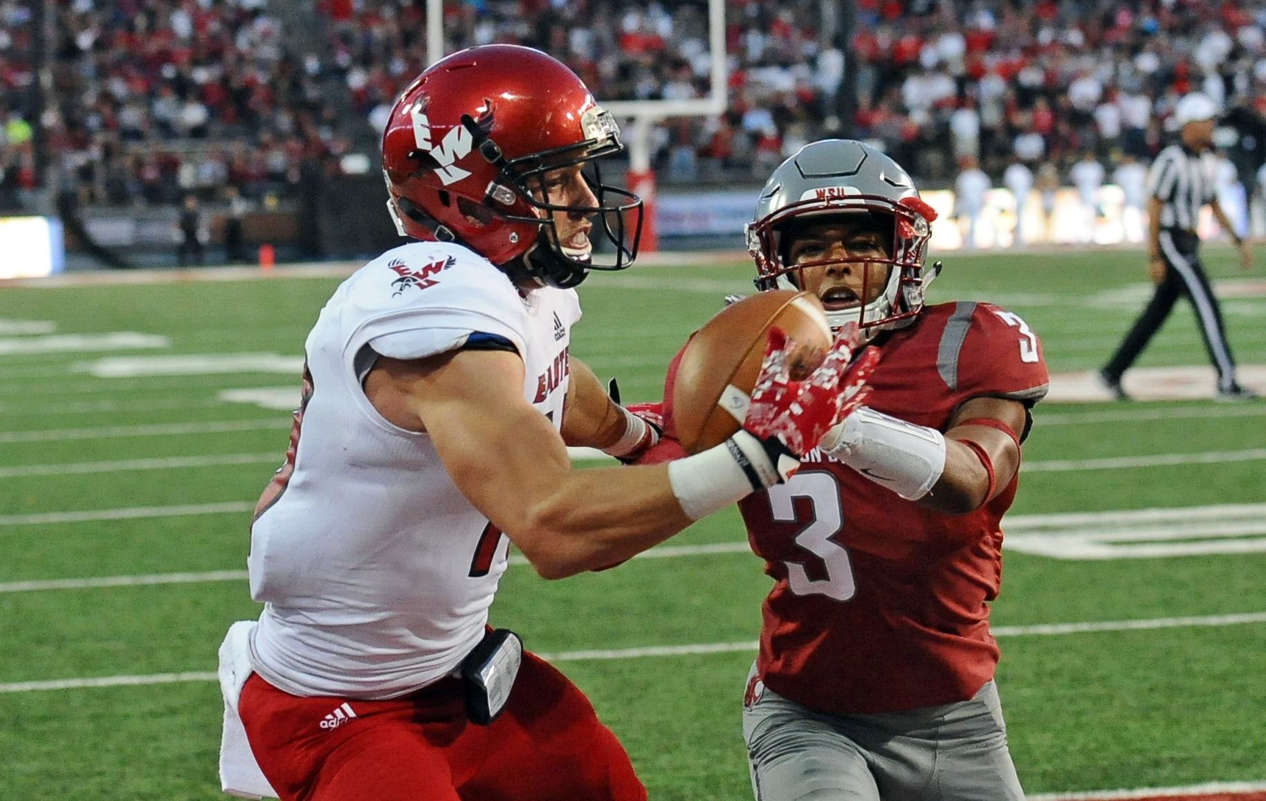 Sep 3, 2016; Pullman, WA, USA; Eastern Washington Eagles wide receiver Cooper Kupp (10) makes a touchdown catch against Washington State Cougars defensive lineman Samson Ebukam (3) during the second half at Martin Stadium. The Eagles won 45-42. Mandatory Credit: James Snook-USA TODAY Sports