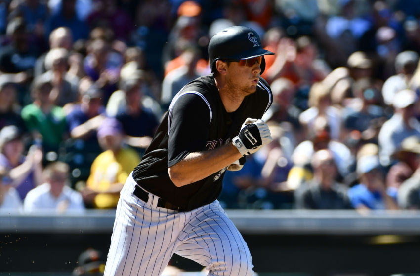 Sep 5, 2016; Denver, CO, USA; Colorado Rockies second baseman DJ LeMahieu (9) runs out a single in the first inning against the San Francisco Giants at Coors Field. Mandatory Credit: Ron Chenoy-USA TODAY Sports
