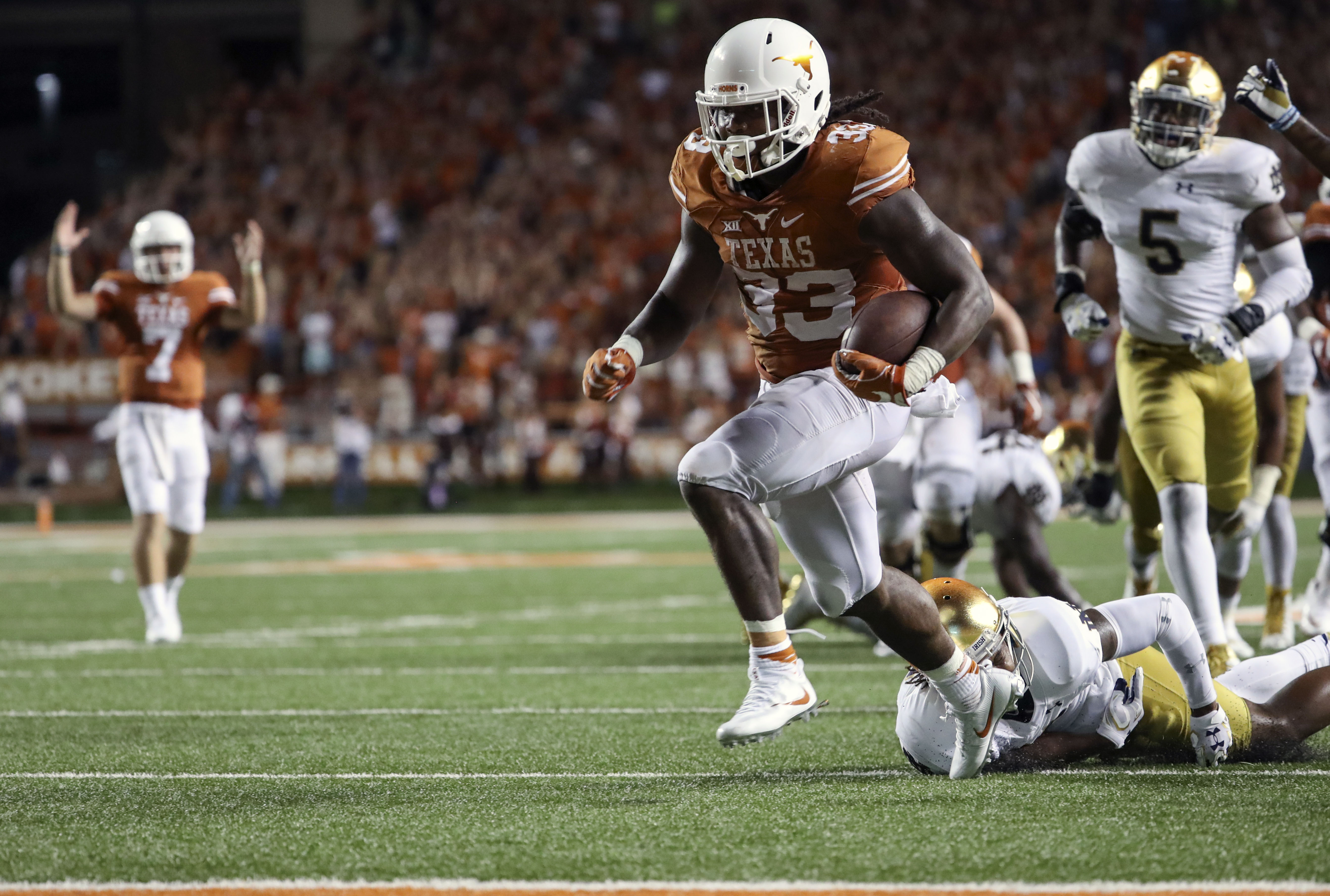 Sep 4, 2016; Austin, TX, USA; Texas Longhorns running back D'Onta Foreman (33) scores a touchdown during the game against the Notre Dame Fighting Irish at Darrell K Royal-Texas Memorial Stadium. Mandatory Credit: Kevin Jairaj-USA TODAY Sports