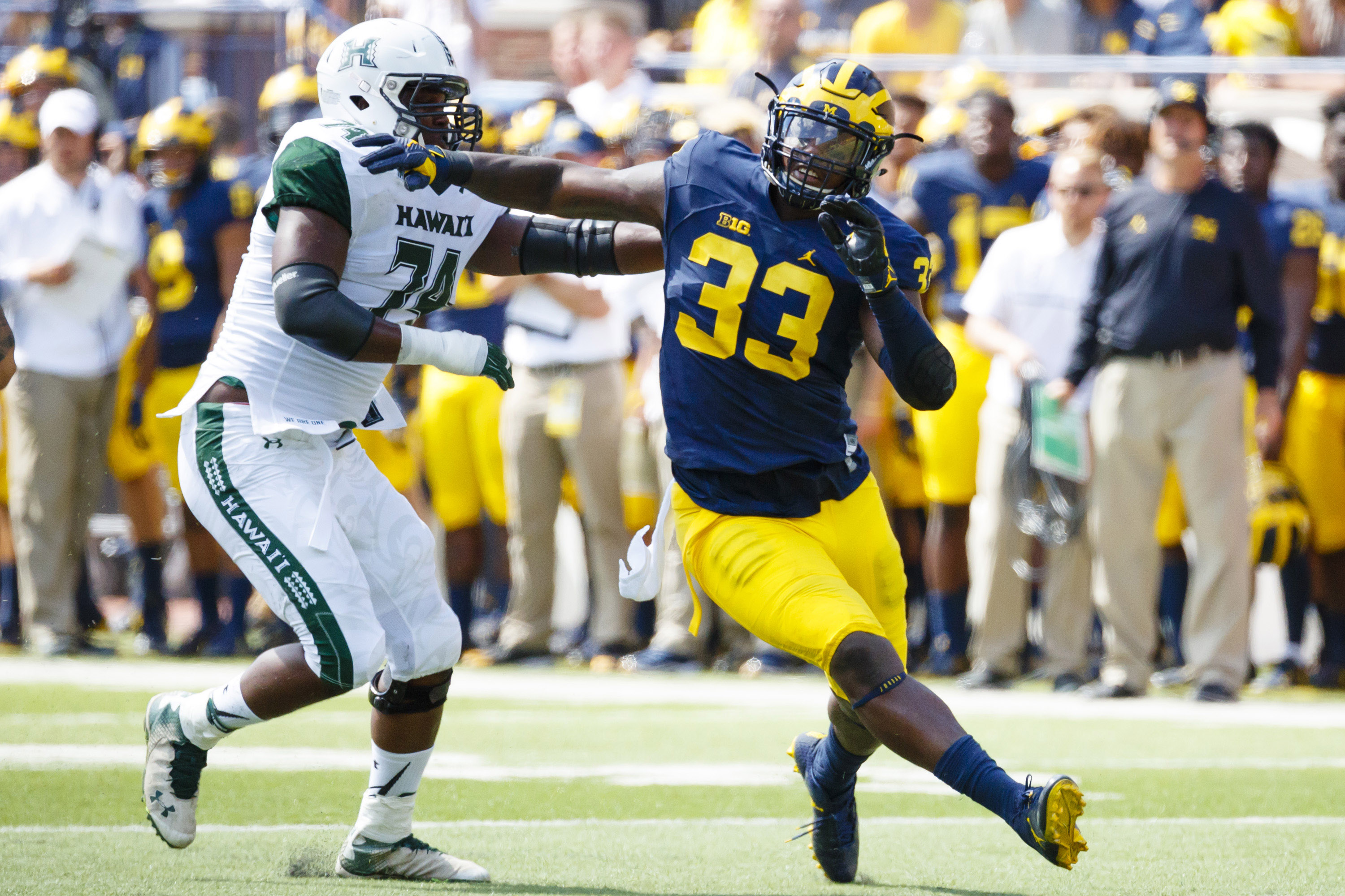 Sep 3, 2016; Ann Arbor, MI, USA; Michigan Wolverines defensive end Taco Charlton (33) rushes on Hawaii Warriors offensive lineman RJ Hollis (74) at Michigan Stadium. Mandatory Credit: Rick Osentoski-USA TODAY Sports