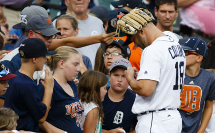 Aug 30, 2016; Detroit, MI, USA; Detroit Tigers center fielder Tyler Collins (18) signs autographs prior to the game against the Chicago White Sox at Comerica Park. Mandatory Credit: Rick Osentoski-USA TODAY Sports