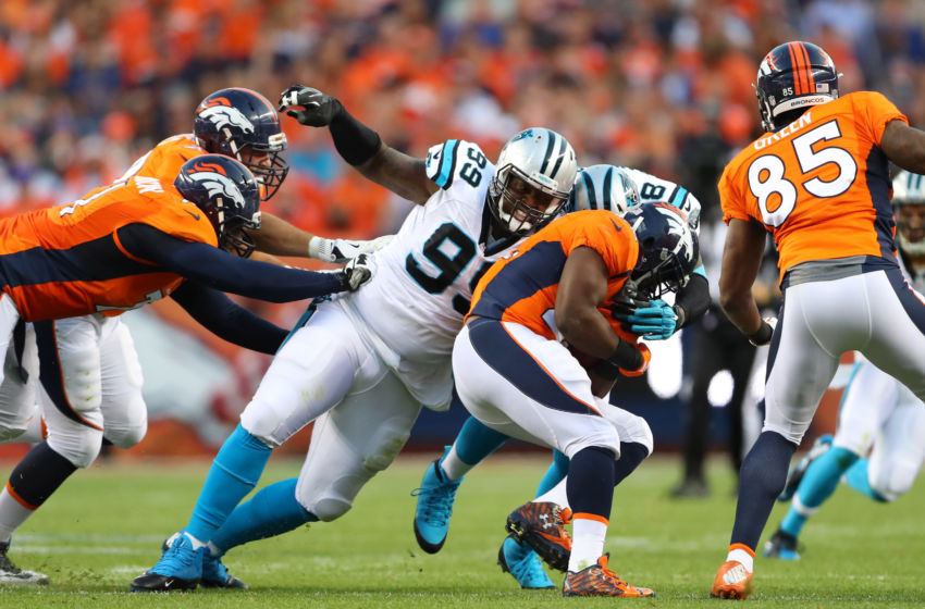 Sep 8, 2016; Denver, CO, USA; Carolina Panthers defensive tackle Kawann Short (99) tackles Denver Broncos running back C.J. Anderson in the first quarter at Sports Authority Field at Mile High. Mandatory Credit: Mark J. Rebilas-USA TODAY Sports