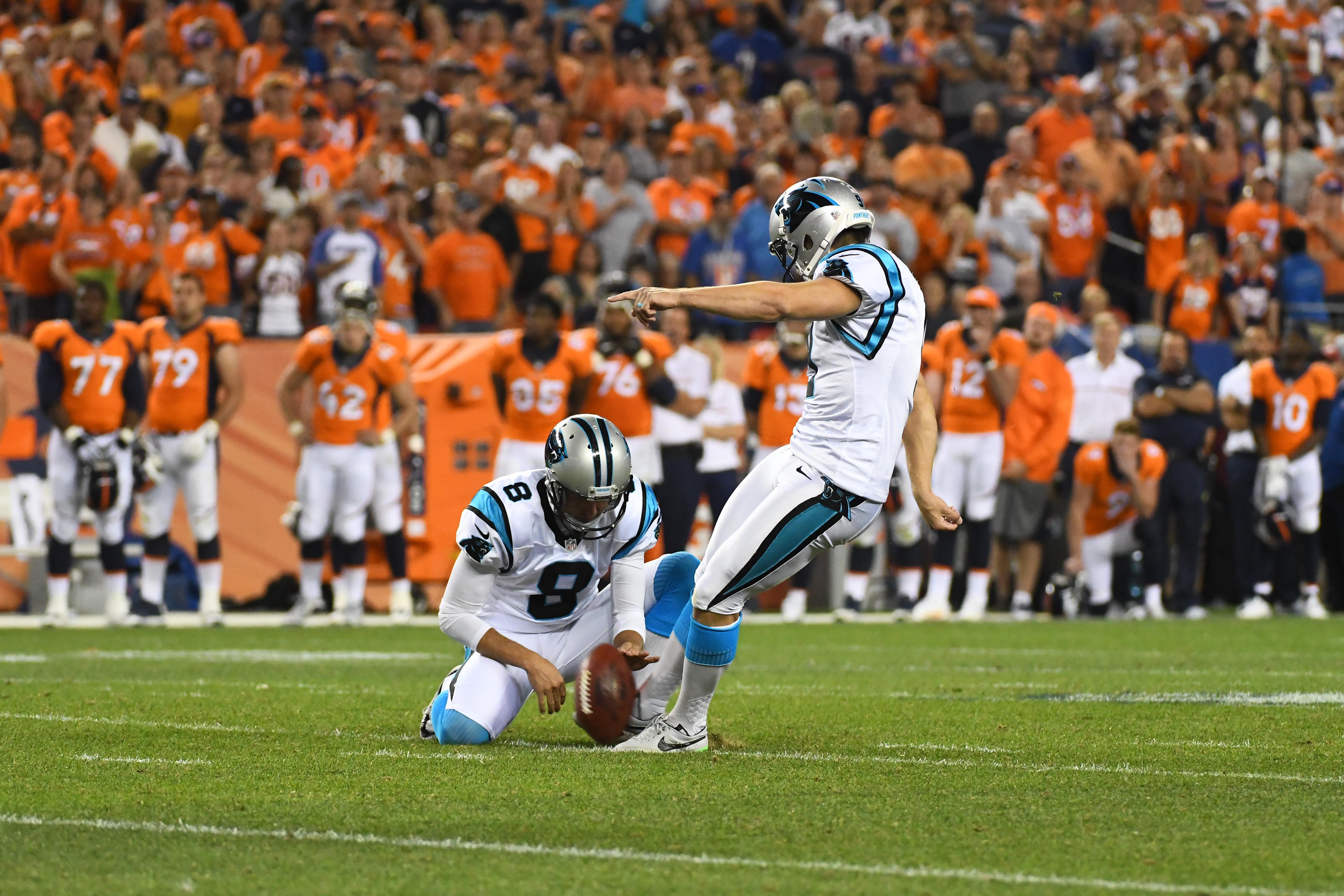 Sep 8, 2016; Denver, CO, USA; Carolina Panthers kicker Graham Gano (9) misses a fifty yard field goal attempt as punter Andy Lee (8) holds in the fourth quarter against the Denver Broncos at Sports Authority Field at Mile High. The Broncos defeated the Panthers 21-20. Mandatory Credit: Ron Chenoy-USA TODAY Sports