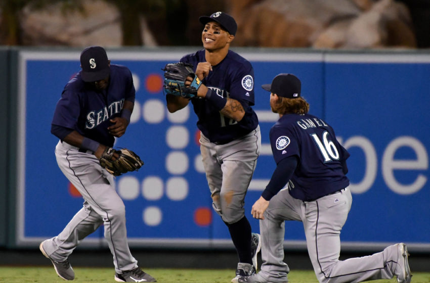 Sep 12, 2016; Anaheim, CA, USA; Seattle Mariners center fielder Leonys Martin (12), left fielder Guillermo Heredia (5) and left fielder Ben Gamel (16) celebrate the Mariners 8-1 win over the Los Angeles Angels at Angel Stadium of Anaheim. Mandatory Credit: Robert Hanashiro-USA TODAY Sports