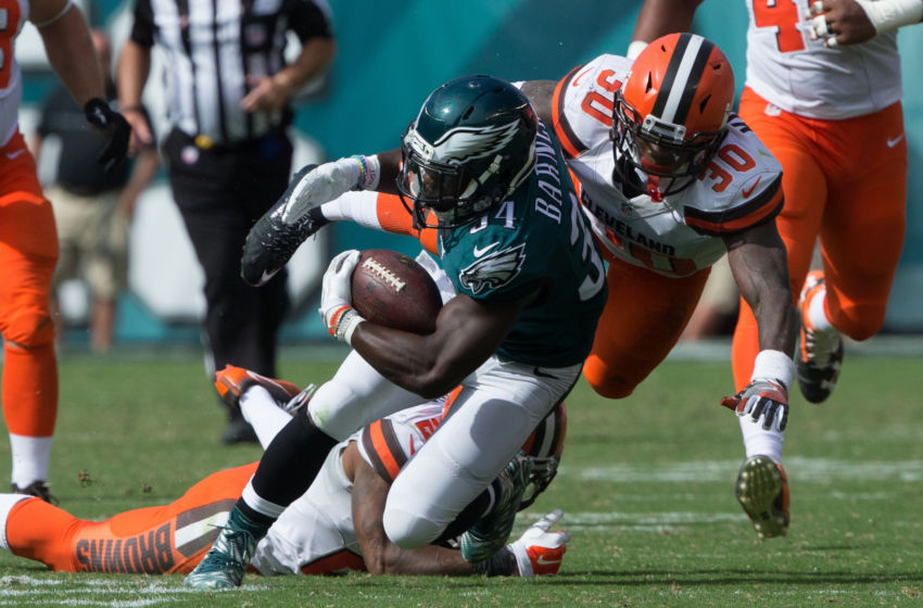 Sep 11, 2016; Philadelphia, PA, USA; Philadelphia Eagles running back Kenjon Barner (34) is tackled by Cleveland Browns free safety Derrick Kindred (30) at Lincoln Financial Field. The Eagles won 29-10. Mandatory Credit: Bill Streicher-USA TODAY Sports