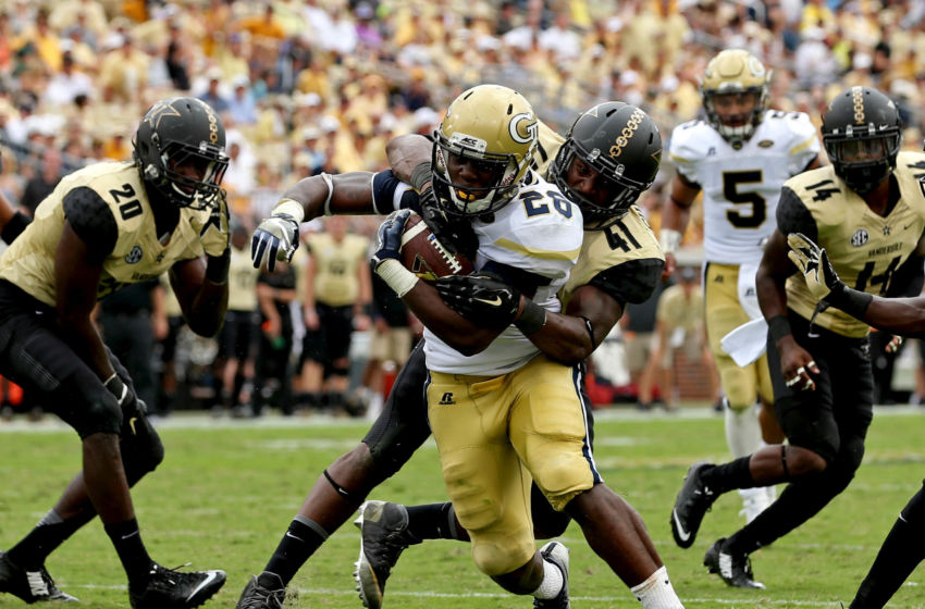 Sep 17, 2016; Atlanta, GA, USA; Georgia Tech Yellow Jackets running back Dedrick Mills (26) scores a rushing touchdown against Vanderbilt Commodores linebacker Zach Cunningham (41) in the third quarter of their game at Bobby Dodd Stadium. The Yellow Jackets won 38-7. Mandatory Credit: Jason Getz-USA TODAY Sports