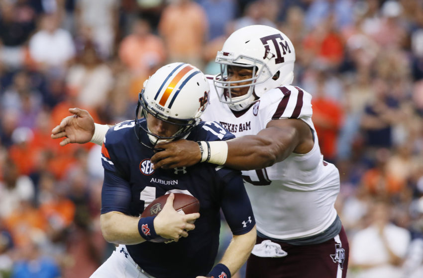 Sep 17, 2016; Auburn, AL, USA; Texas A&M Aggies lineman Myles Garrett (15) tackles Auburn Tigers quarterback Sean White (13) during the first quarter at Jordan Hare Stadium. Mandatory Credit: John Reed-USA TODAY Sports