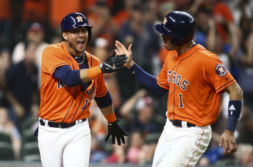 Sep 23, 2016; Houston, TX, USA; Houston Astros third baseman Yulieski Gurriel (10) and shortstop Carlos Correa (1) celebrate after scoring runs during the sixth inning against the Los Angeles Angels at Minute Maid Park. Mandatory Credit: Troy Taormina-USA TODAY Sports