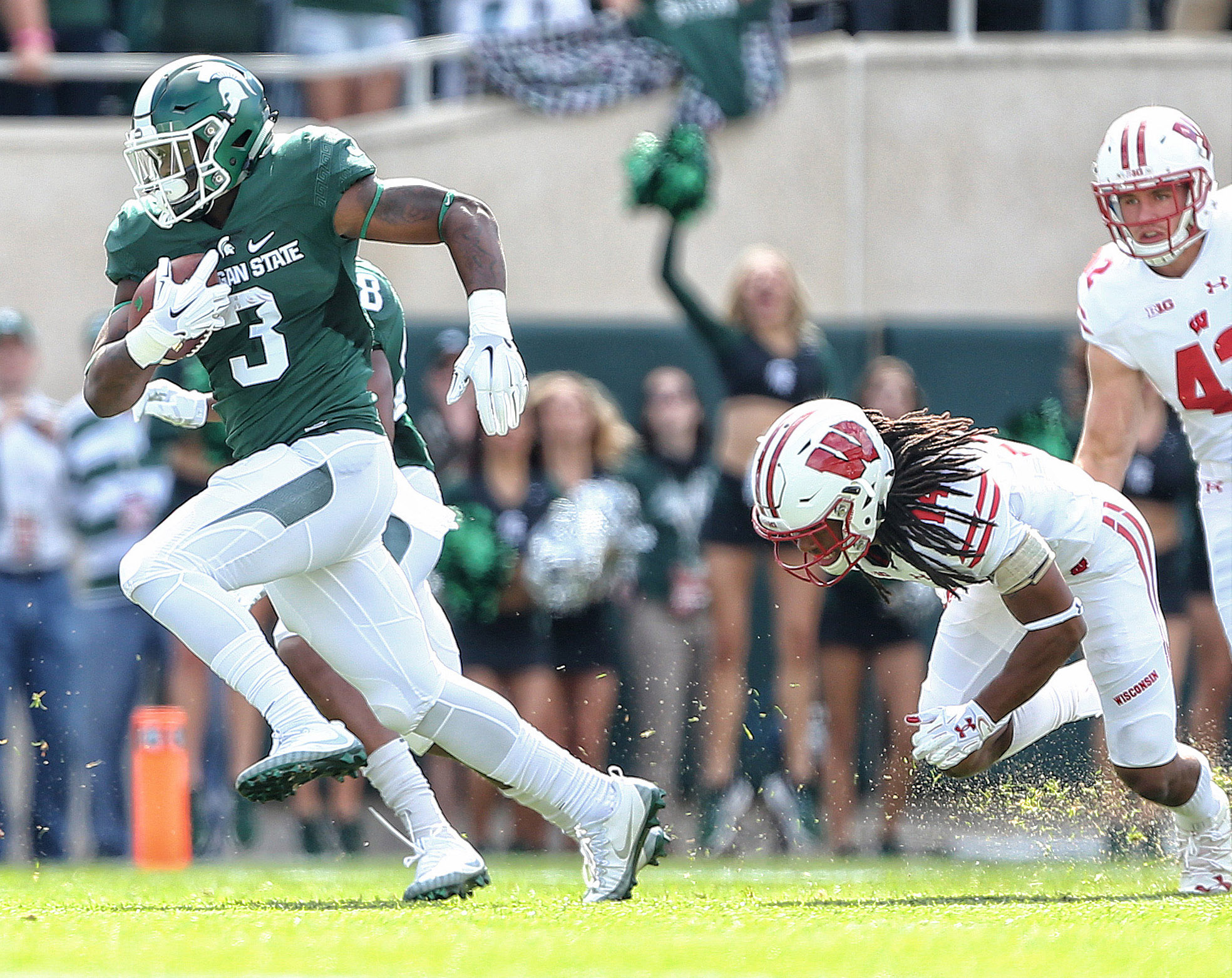 Sep 24, 2016; East Lansing, MI, USA; Michigan State Spartans running back LJ Scott (3) runs the ball during the first quarter of a game against the Wisconsin Badgers at Spartan Stadium. Mandatory Credit: Mike Carter-USA TODAY Sports