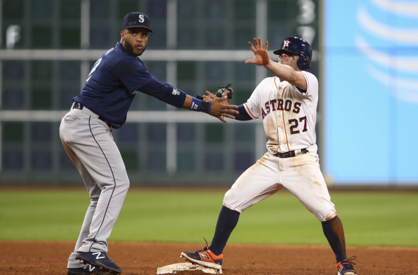 Sep 26, 2016; Houston, TX, USA; Houston Astros second baseman Jose Altuve (27) calls for time out after stealing a base during the ninth inning as Seattle Mariners second baseman Robinson Cano (22) attempts to apply a tag at Minute Maid Park. Mandatory Credit: Troy Taormina-USA TODAY Sports