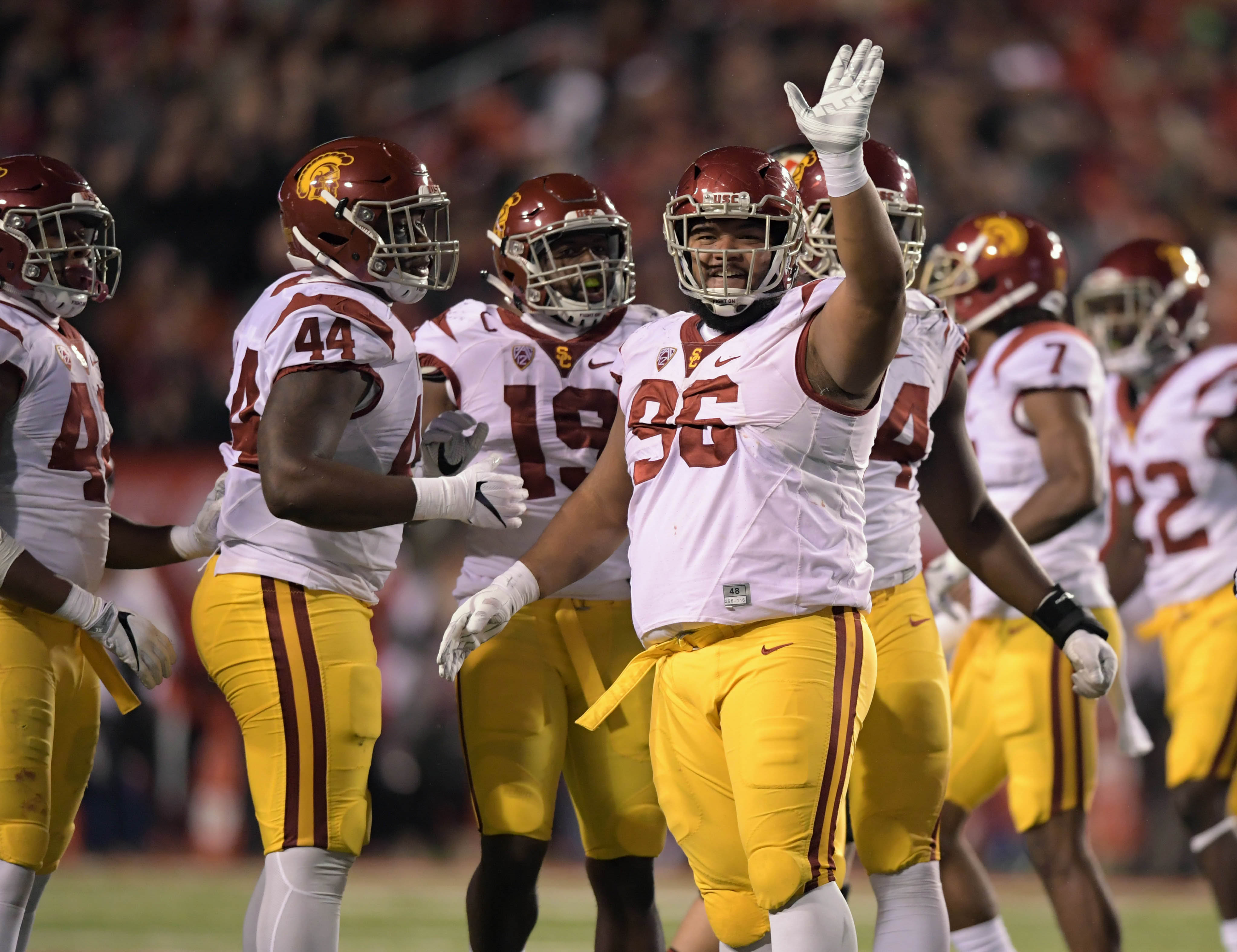 Sep 23, 2016; Salt Lake City, UT, USA; USC Trojans defensive tackle Stevie Tu'ikolovatu (96) celebrates with defensive tackle Malik Dorton (44) and linebacker Michael Hutchings (19) during a NCAA football game at Rice-Eccles Stadium. Utah defeated USC 31-27. Mandatory Credit: Kirby Lee-USA TODAY Sports