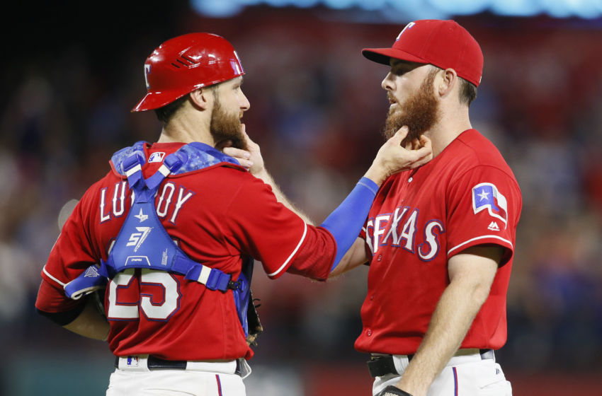 Sep 30, 2016; Arlington, TX, USA; Texas Rangers catcher Jonathan Lucroy (25) touches the beard of relief pitcher Sam Dyson (47) after the game against the Tampa Bay Rays at Globe Life Park in Arlington. Texas won 3-1. Mandatory Credit: Tim Heitman-USA TODAY Sports