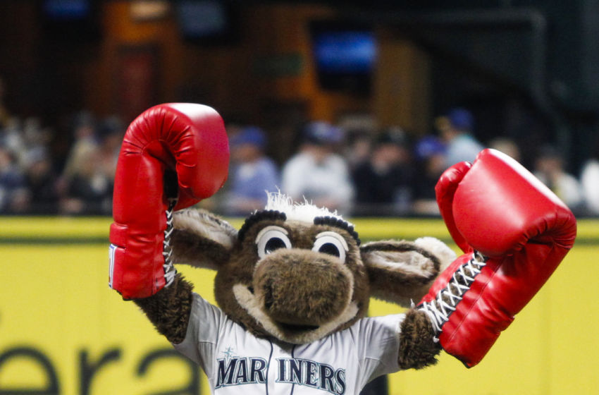 Sep 30, 2016; Seattle, WA, USA; Seattle Mariners mascot Moose walks on the field with boxing gloves before the first inning against the Oakland Athletics at Safeco Field. Mandatory Credit: Joe Nicholson-USA TODAY Sports