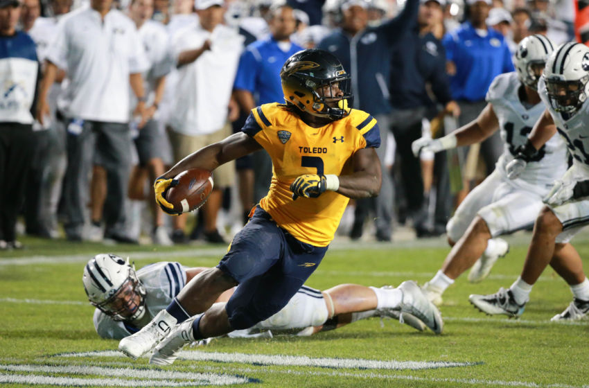 Sep 30, 2016; Provo, UT, USA;  Toledo Rockets running back Kareem Hunt (3) tries to find a way around the Brigham Young Cougars defense during the fourth quarter at Lavell Edwards Stadium. Brigham Young won 55-53. Mandatory Credit: Chris Nicoll-USA TODAY Sports
