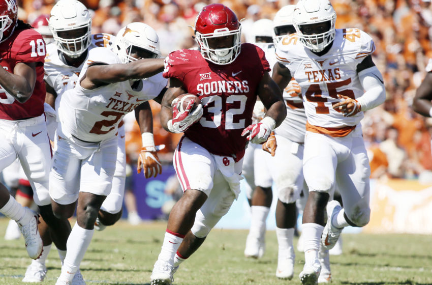 Oct 8, 2016; Dallas, TX, USA; Oklahoma Sooners running back Samaje Perine (32) runs the ball against the Texas Longhorns in the second quarter at Cotton Bowl. Mandatory Credit: Tim Heitman-USA TODAY Sports