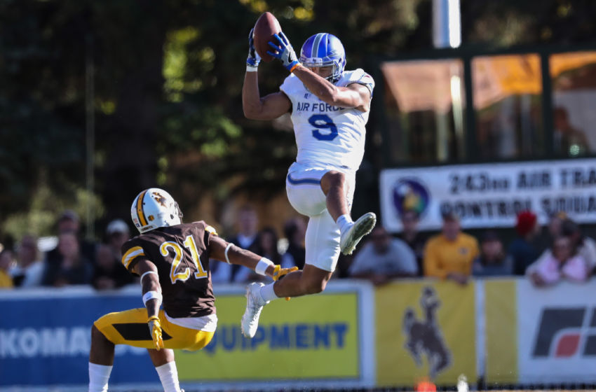Oct 8, 2016; Laramie, WY, USA; Air Force Falcons wide receiver Jalen Robinette (9) makes a catch against Wyoming Cowboys cornerback Antonio Hull (21) during the third quarter at War Memorial Stadium. The Cowboys beat the Falcons 35-26. Mandatory Credit: Troy Babbitt-USA TODAY Sports