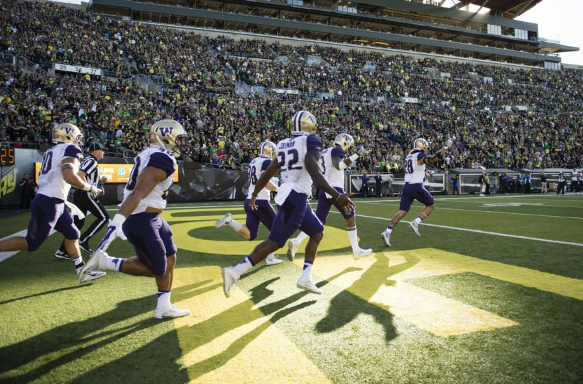 Oct 8, 2016; Eugene, OR, USA; The University of Washington Huskies football team takes the field before the start of a game against the University of Oregon at Autzen Stadium. The Huskies won 70-21. Mandatory Credit: Troy Wayrynen-USA TODAY Sports