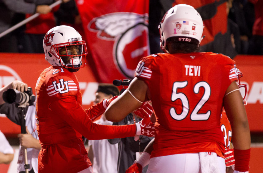Oct 8, 2016; Salt Lake City, UT, USA; Utah Utes wide receiver Tyrone Smith (Left) and offensive tackle Sam Tevi (52) react to a touchdown by Smith during the first half against the Arizona Wildcats at Rice-Eccles Stadium. Mandatory Credit: Russ Isabella-USA TODAY Sports