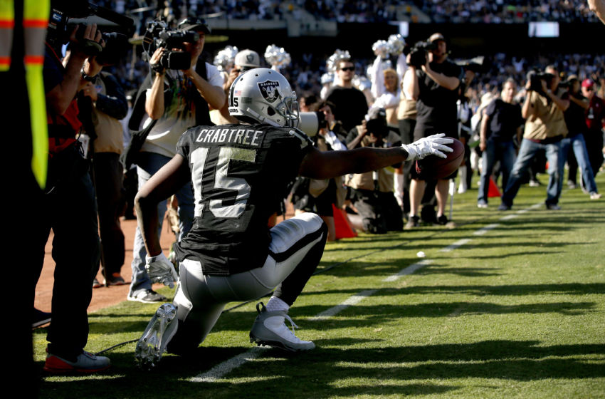 Oct 9, 2016; Oakland, CA, USA; Oakland Raiders wide receiver Michael Crabtree (15) reacts after catching a touchdown pass against the San Diego Chargers in the third quarter at Oakland Coliseum. The Raiders defeated the Chargers 34-31. Mandatory Credit: Cary Edmondson-USA TODAY Sports