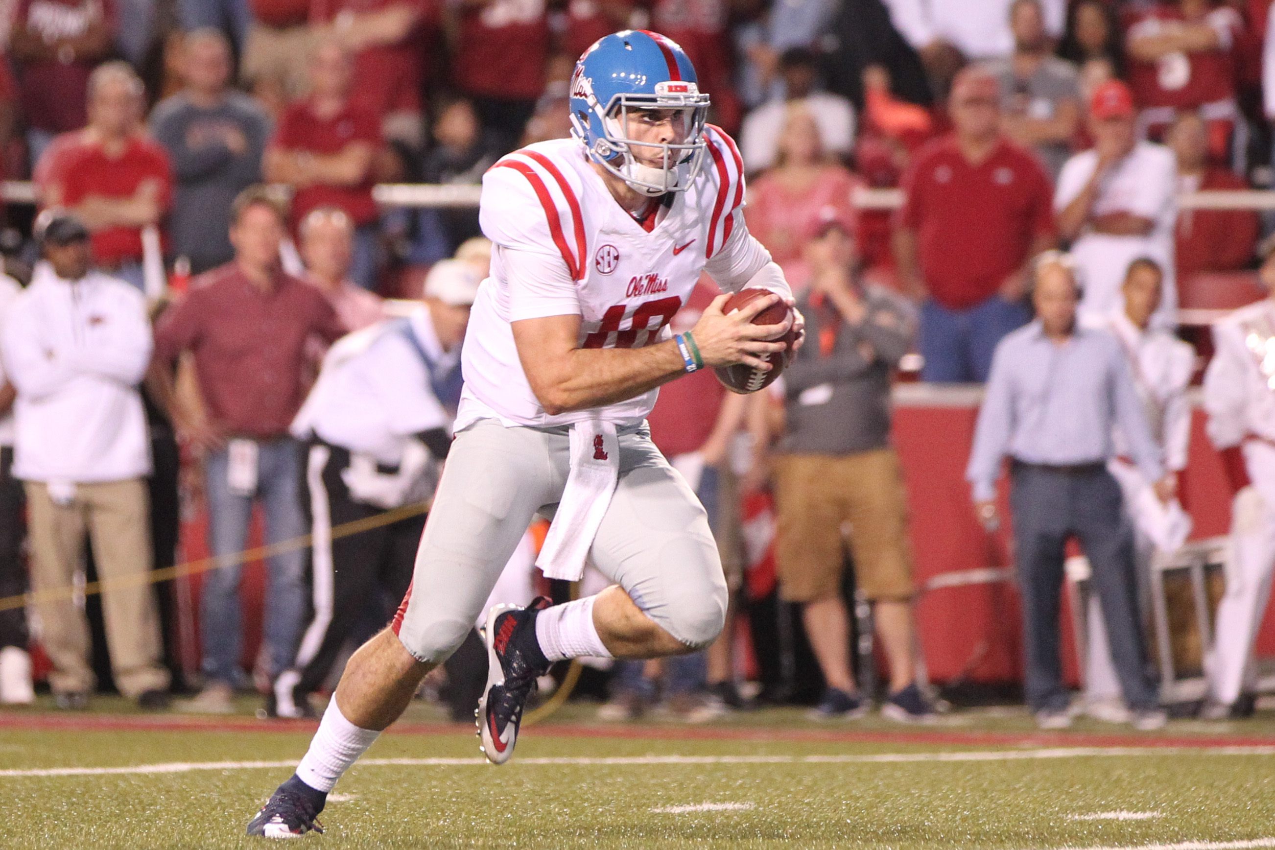 Oct 15, 2016; Fayetteville, AR, USA; Ole Miss Rebels quarterback Chad Kelly (10) rushes for a touchdown in the second quarter against the Arkansas Razorbacks at Donald W. Reynolds Razorback Stadium. Mandatory Credit: Nelson Chenault-USA TODAY Sports