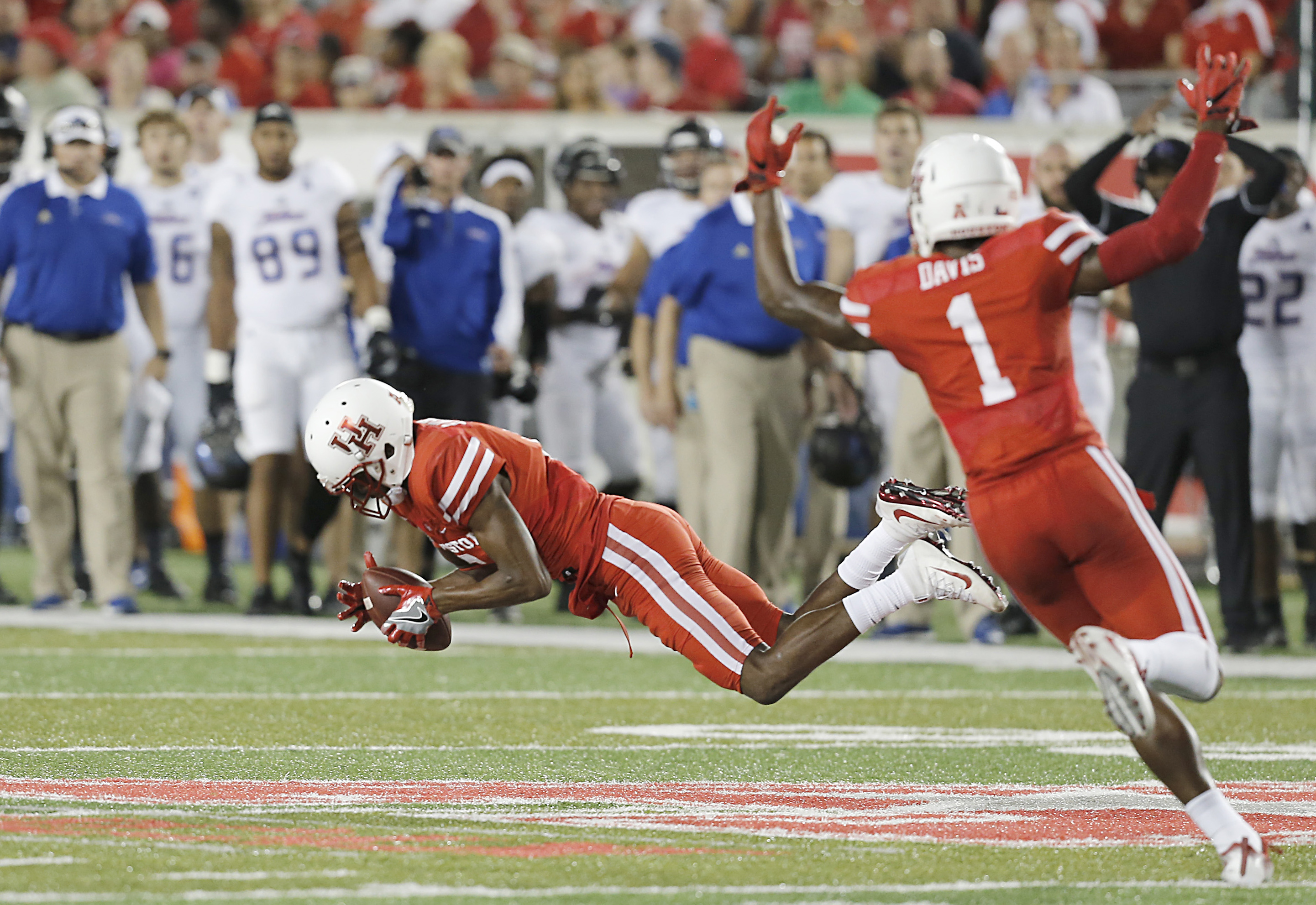 Oct 15, 2016; Houston, TX, USA; Houston Cougars cornerback Howard Wilson (6) intercepts the ball against the Tulsa Golden Hurricane in the second quarter at TDECU Stadium. Mandatory Credit: Thomas B. Shea-USA TODAY Sports