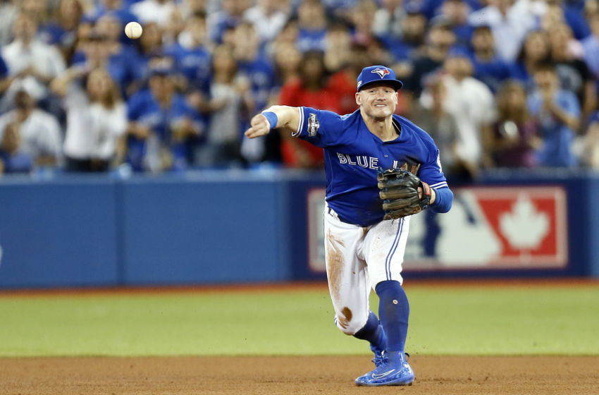 Oct 18, 2016; Toronto, Ontario, CAN; Toronto Blue Jays third baseman Josh Donaldson (20) throws to first base for an out during the fifth inning against the Cleveland Indians in game four of the 2016 ALCS playoff baseball series at Rogers Centre. Mandatory Credit: John E. Sokolowski-USA TODAY Sports
