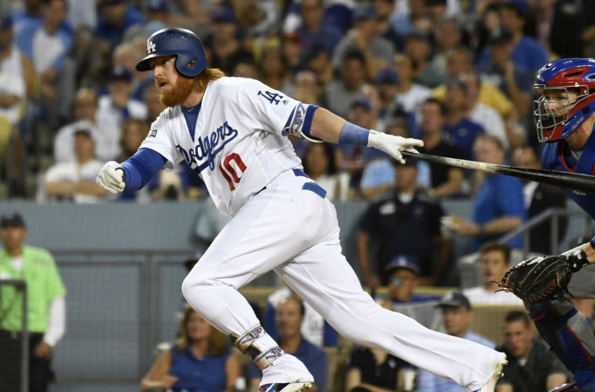 Oct 20, 2016; Los Angeles, CA, USA; Los Angeles Dodgers third baseman Justin Turner (10) connects for a single in the third inning against the Chicago Cubs in game five of the 2016 NLCS playoff baseball series against the Los Angeles Dodgers at Dodger Stadium. Mandatory Credit: Richard Mackson-USA TODAY Sports