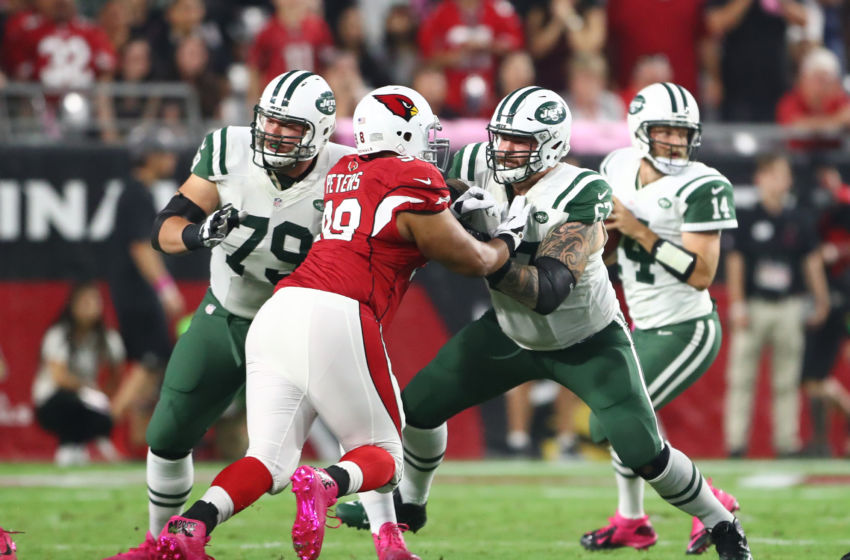 Oct 17, 2016; Glendale, AZ, USA; New York Jets offensive lineman Brent Qvale (79) and guard Brian Winters (67) block Arizona Cardinals defensive tackle Corey Peters at University of Phoenix Stadium. The Cardinals defeated the Jets 28-3. Mandatory Credit: Mark J. Rebilas-USA TODAY Sports