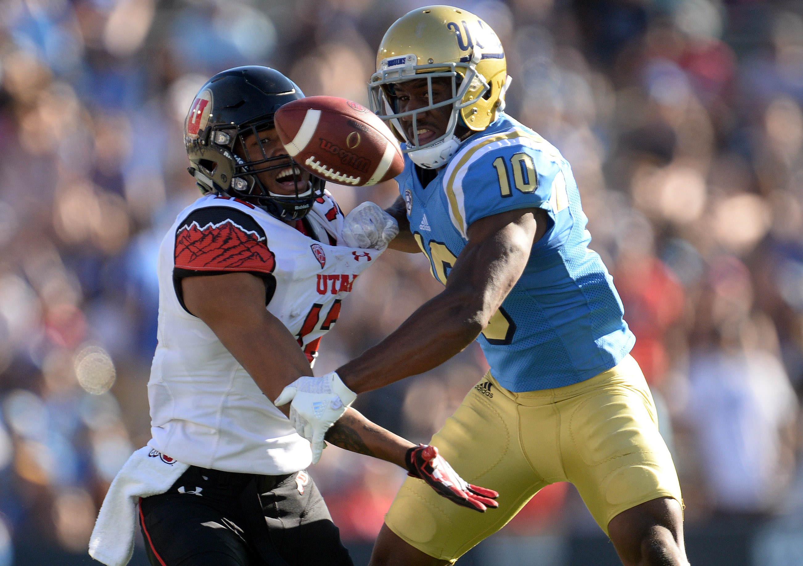 October 22, 2016; Pasadena, CA, USA; UCLA Bruins defensive back Fabian Moreau (10) defends but is called for pass interfence against Utah Utes wide receiver Tim Patrick (12) during the second half at the Rose Bowl. Mandatory Credit: Gary A. Vasquez-USA TODAY Sports
