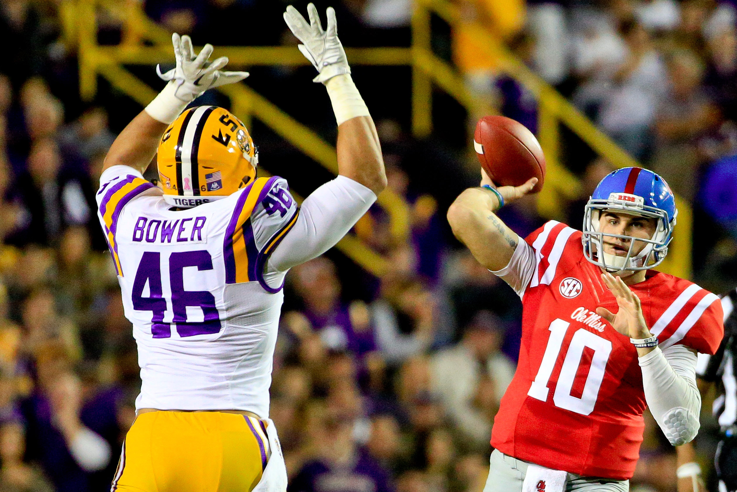 Oct 22, 2016; Baton Rouge, LA, USA; Mississippi Rebels quarterback Chad Kelly (10) throws past LSU Tigers defensive end Tashawn Bower (46) during the first half of a game at Tiger Stadium. Mandatory Credit: Derick E. Hingle-USA TODAY Sports