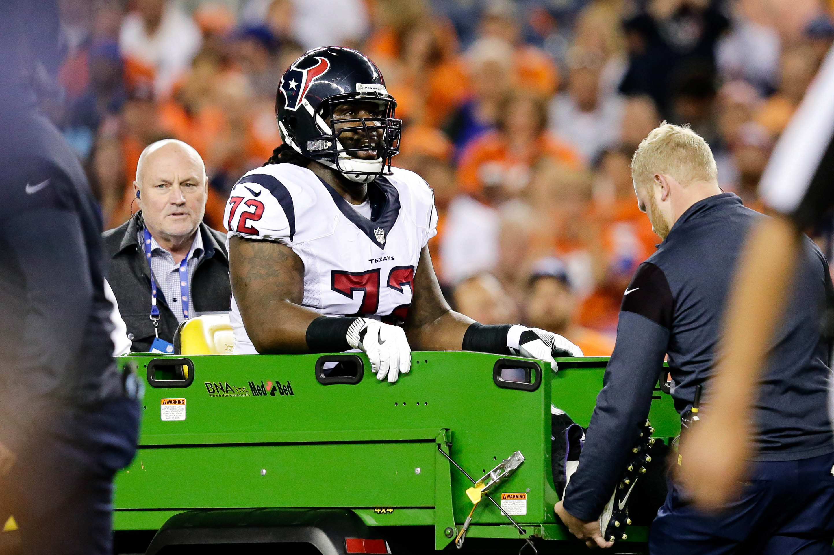 Oct 24, 2016; Denver, CO, USA; Houston Texans tackle Derek Newton (72) is carted off the field in the first quarter against the Denver Broncos at Sports Authority Field at Mile High. Mandatory Credit: Isaiah J. Downing-USA TODAY Sports