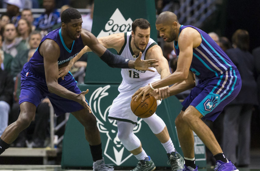 Oct 26, 2016; Milwaukee, WI, USA; Milwaukee Bucks center Miles Plumlee (18) (center), Charlotte Hornets center Roy Hibbert (55) (left) and guard Nicolas Batum (5) (right) reach for the loose ball during the first quarter at BMO Harris Bradley Center. Mandatory Credit: Jeff Hanisch-USA TODAY Sports