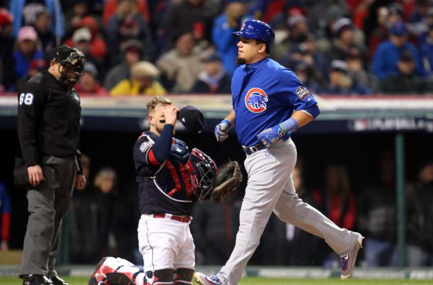 Oct 26, 2016; Cleveland, OH, USA; Chicago Cubs player Kyle Schwarber (12) scores a run against the Cleveland Indians in the 5th inning in game two of the 2016 World Series at Progressive Field. Mandatory Credit: Charles LeClaire-USA TODAY Sports