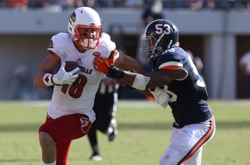 Oct 29, 2016; Charlottesville, VA, USA; Louisville Cardinals tight end Cole Hikutini (18) runs with the ball as Virginia Cavaliers linebacker Micah Kiser (53) chases in the fourth quarter at Scott Stadium. The Cardinals won 32-25. Mandatory Credit: Geoff Burke-USA TODAY Sports