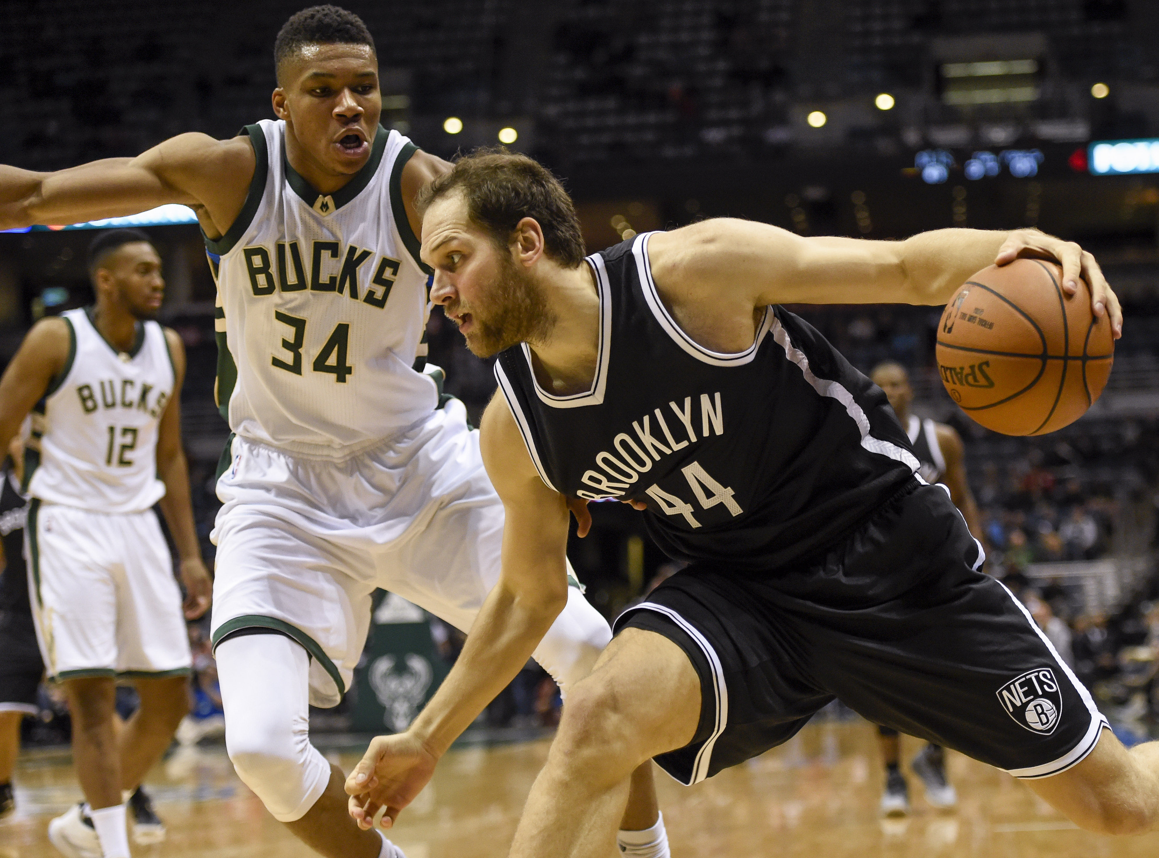 Oct 29, 2016; Milwaukee, WI, USA; Brooklyn Nets guard Bojan Bogdanovic (44) dribbles the ball in front of Milwaukee Bucks forward Giannis Antetokounmpo (34) in the fourth quarter at BMO Harris Bradley Center. Mandatory Credit: Benny Sieu-USA TODAY Sports