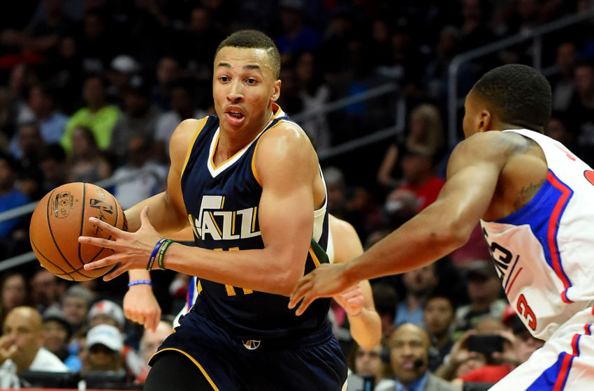 Oct 30, 2016; Los Angeles, CA, USA; Utah Jazz guard Dante Exum (11) drives to the basket against Los Angeles Clippers forward Wesley Johnson (33) in the second half of the game at Staples Center. Clippers won 88-75. Mandatory Credit: Jayne Kamin-Oncea-USA TODAY Sports