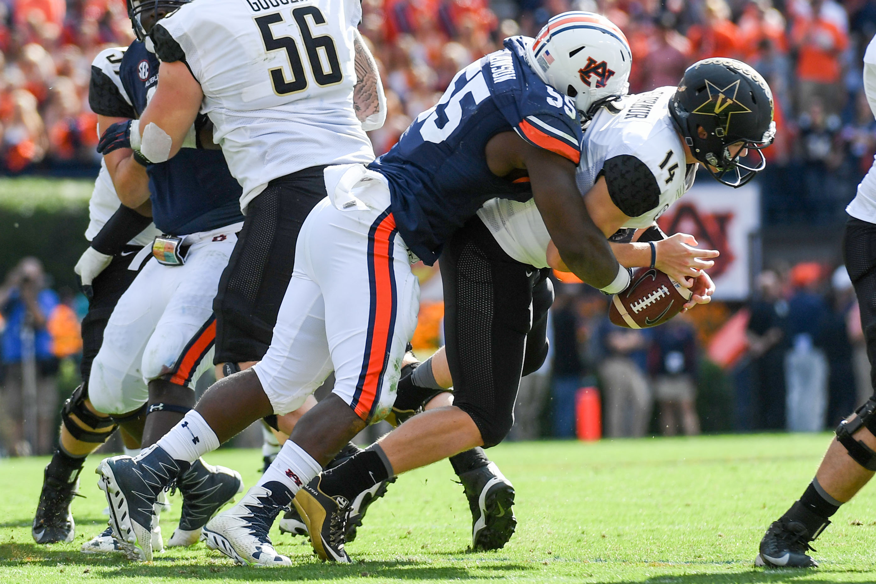 Nov 5, 2016; Auburn, AL, USA; Auburn Tigers defensive lineman Carl Lawson (55) sacks Vanderbilt Commodores quarterback Kyle Shurmur (14) during the fourth quarter at Jordan Hare Stadium. Auburn won 23-16. Mandatory Credit: Shanna Lockwood-USA TODAY Sports