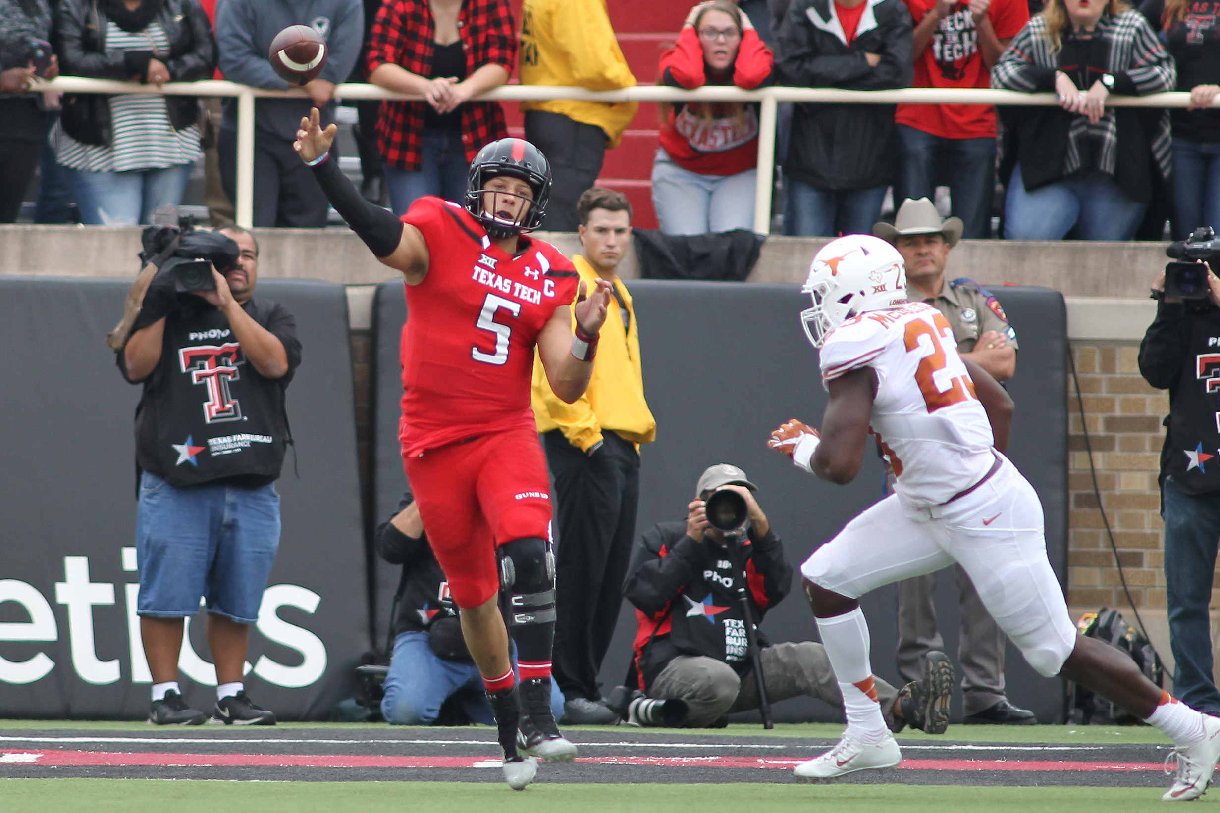 Nov 5, 2016; Lubbock, TX, USA; Texas Tech Red Raiders quarterback Patrick Mahomes (5) throws a pass against the University of Texas Longhorns in the second half at Jones AT&T Stadium. UT defeated Texas Tech 45-37. Mandatory Credit: Michael C. Johnson-USA TODAY Sports