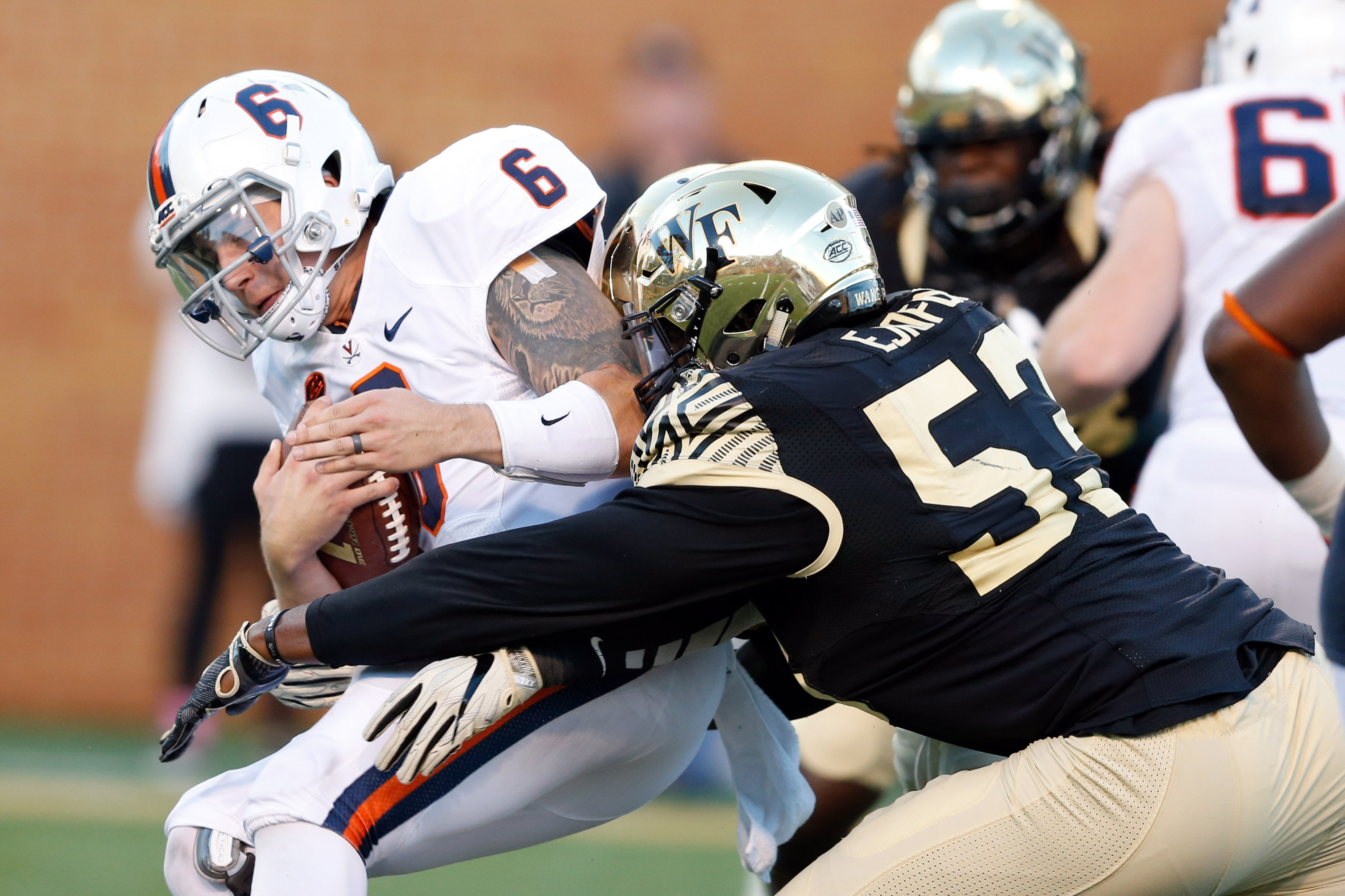 Nov 5, 2016; Winston-Salem, NC, USA; Virginia Cavaliers quarterback Kurt Benkert (6) gets sacked by Wake Forest Demon Deacons defensive lineman Duke Ejiofor (53) in the fourth quarter at BB&T Field. The Demon Deacons defeated the Cavaliers 27-20. Mandatory Credit: Jeremy Brevard-USA TODAY Sports