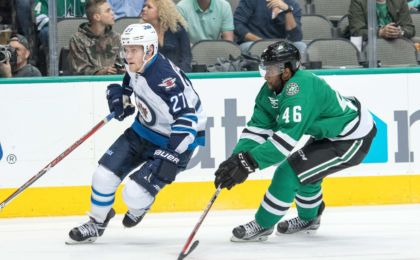 Oct 25, 2016; Dallas, TX, USA; Winnipeg Jets right wing Nikolaj Ehlers (27) and Dallas Stars center Gemel Smith (46) in action during the game at the American Airlines Center. The Stars defeat the Jets 3-2. Mandatory Credit: Jerome Miron-USA TODAY Sports