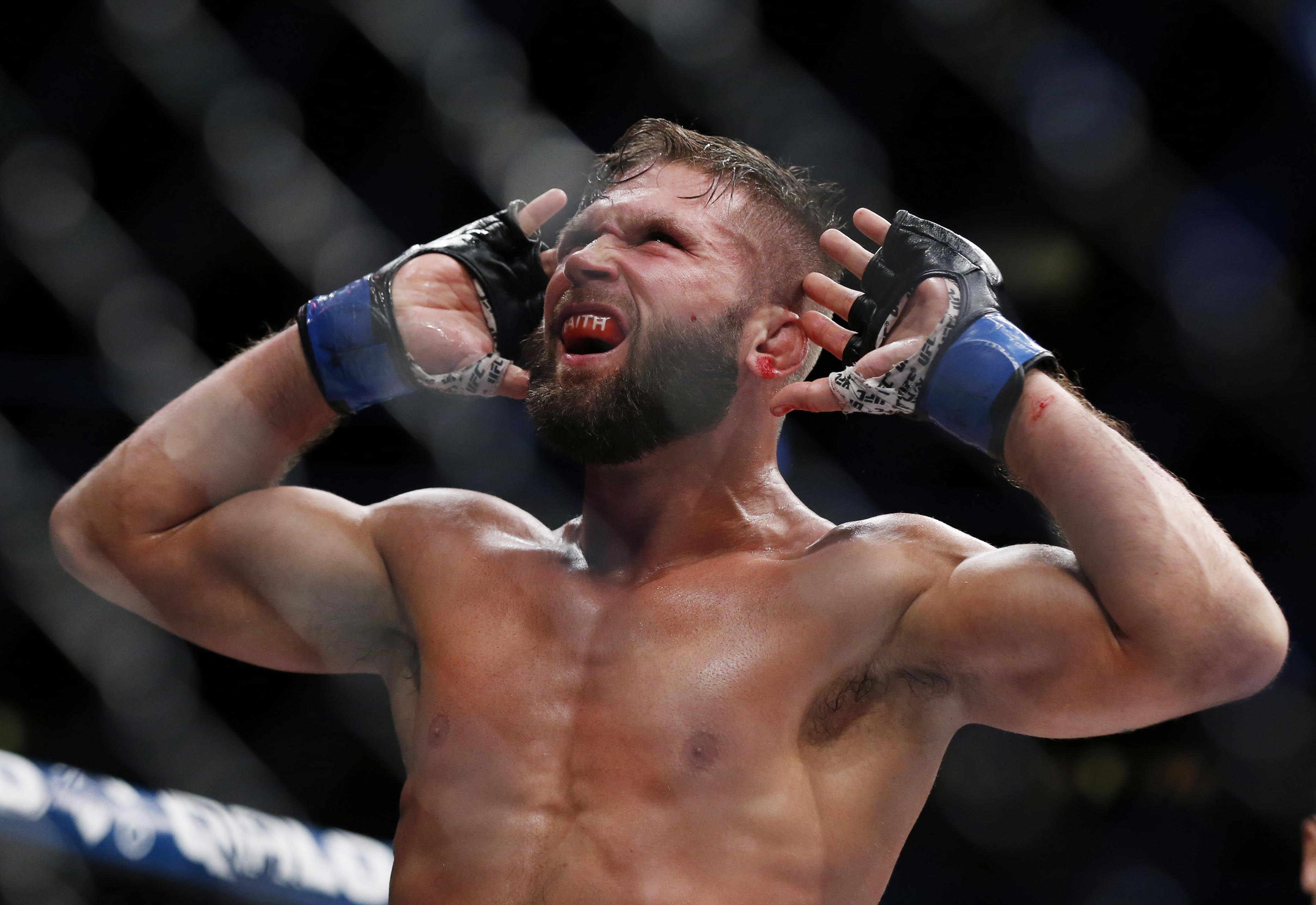 Nov 12, 2016; New York, NY, USA; Jeremy Stephens (blue gloves) reacts during his fight against Frankie Edgar (red gloves) during UFC 205 at Madison Square Garden. Mandatory Credit: Adam Hunger-USA TODAY Sports