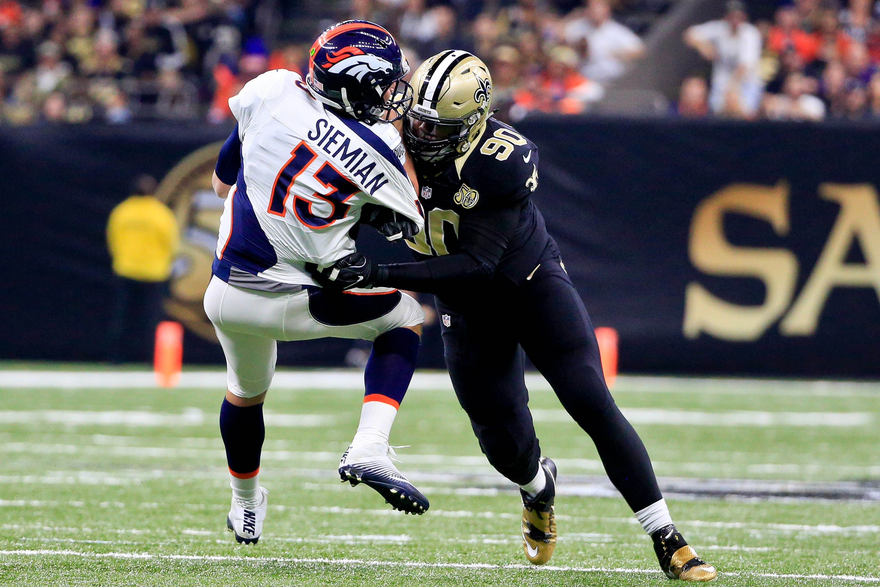 Nov 13, 2016; New Orleans, LA, USA; Denver Broncos quarterback Trevor Siemian (13) is sacked by New Orleans Saints defensive tackle Nick Fairley (90) during the first quarter of a game at the Mercedes-Benz Superdome. Mandatory Credit: Derick E. Hingle-USA TODAY Sports