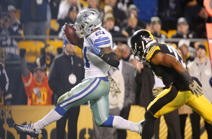 Nov 13, 2016; Pittsburgh, PA, USA; Dallas Cowboys running back Ezekiel Elliott (21) scores on a fourteen yard touchdown run past Pittsburgh Steelers free safety Mike Mitchell (23) during the fourth quarter at Heinz Field. Dallas won 35-30. Mandatory Credit: Charles LeClaire-USA TODAY Sports