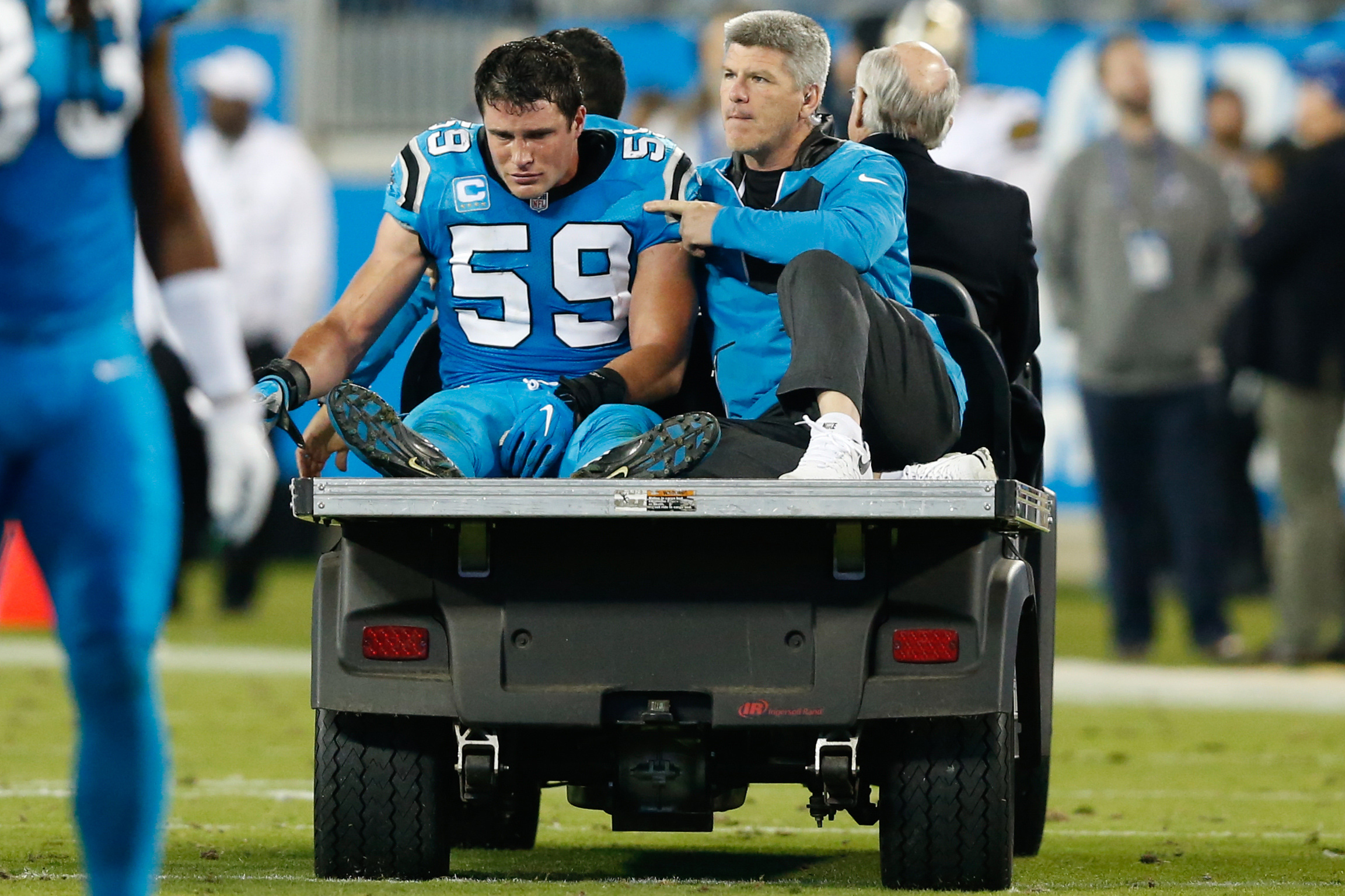 Nov 17, 2016; Charlotte, NC, USA; Carolina Panthers middle linebacker Luke Kuechly (59) rides the cart after an injury in the fourth quarter against the New Orleans Saints at Bank of America Stadium. The Panthers defeated the Saints 23-20. Mandatory Credit: Jeremy Brevard-USA TODAY Sports