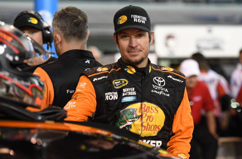 Nov 18, 2016; Homestead, FL, USA; NASCAR Sprint Cup Series driver Martin Truex Jr. (78) looks on during qualifying for the Ford Ecoboost 400 at Homestead-Miami Speedway. Mandatory Credit: Jasen Vinlove-USA TODAY Sports
