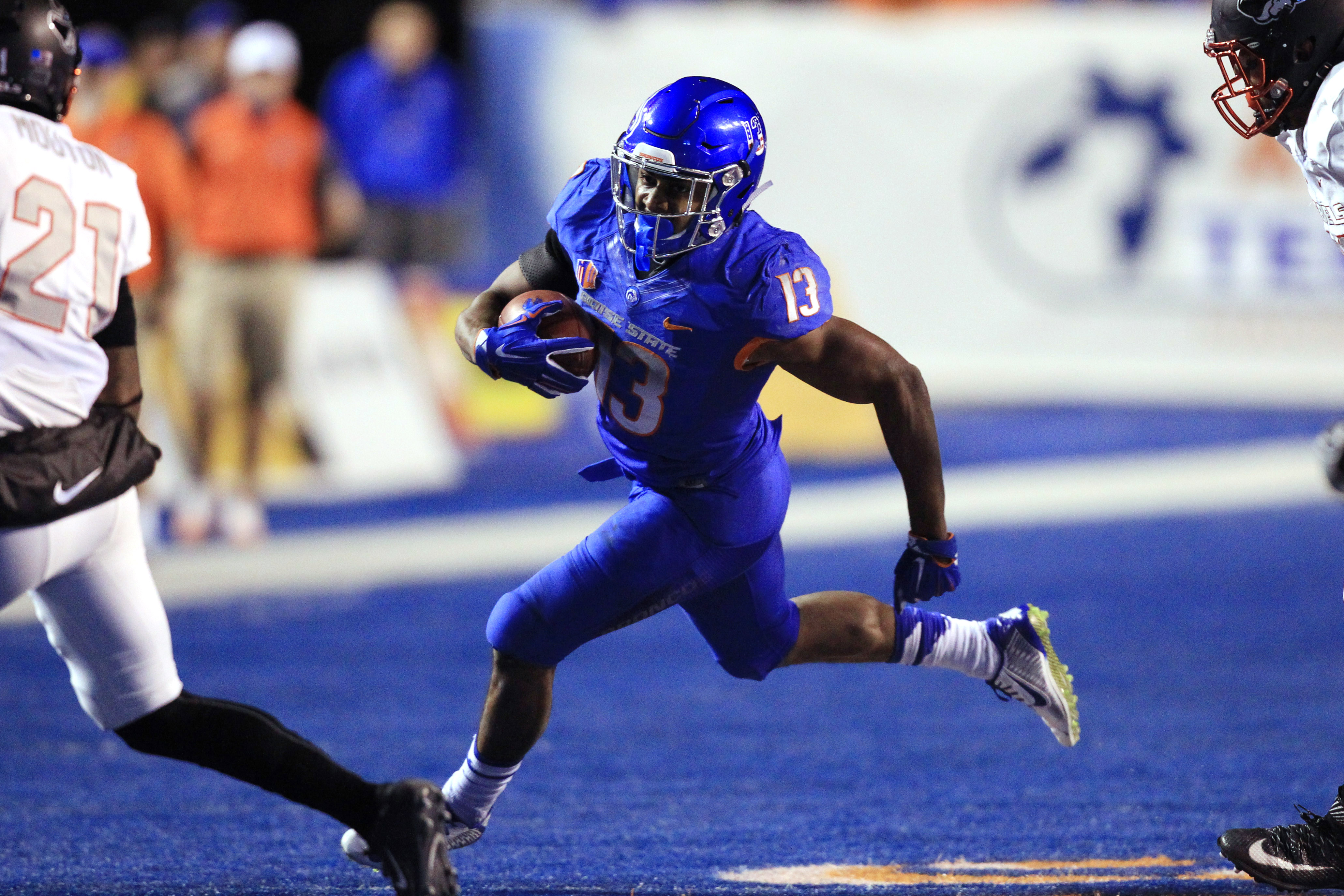 Nov 18, 2016; Boise, ID, USA; Boise State Broncos running back Jeremy McNichols (13) runs the ball against the UNLV Rebels in the first half at Albertsons Stadium. Mandatory Credit: Brian Losness-USA TODAY Sports