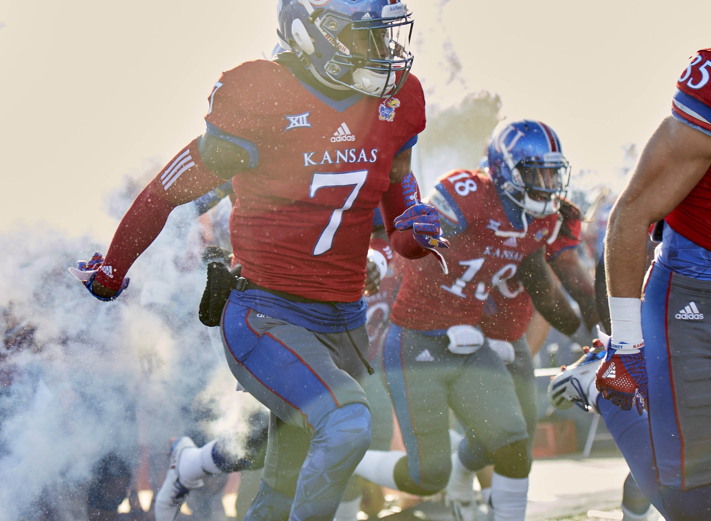 9691024-ncaa-football-texas-at-kansas