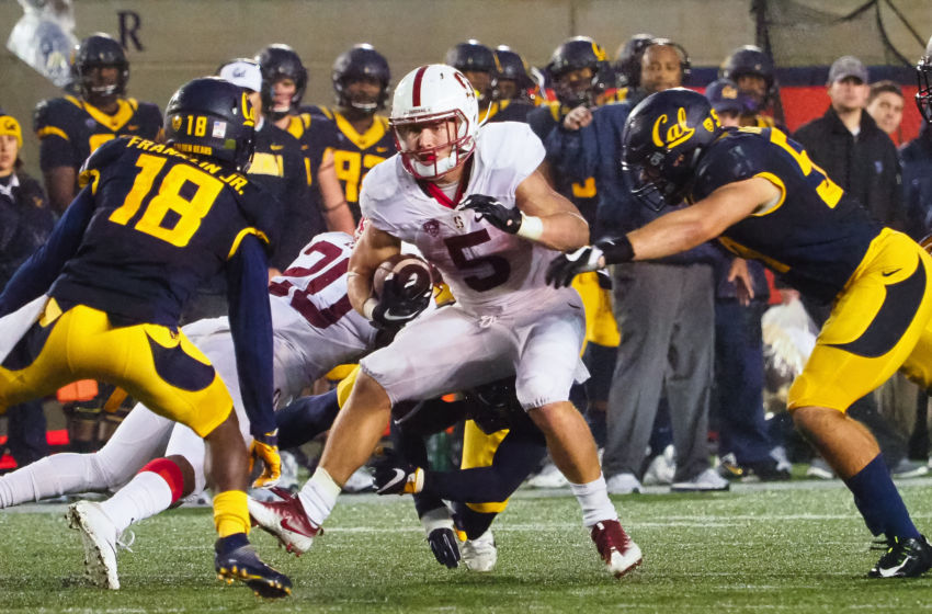 Nov 19, 2016; Berkeley, CA, USA; Stanford Cardinal running back Christian McCaffrey (5) carries the ball against the California Golden Bears during the third quarter at Memorial Stadium. The Stanford Cardinal defeated the California Golden Bears 45-31. Mandatory Credit: Kelley L Cox-USA TODAY Sports